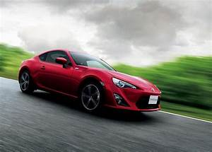 A Red Toyota 86 Travelling At High Speed