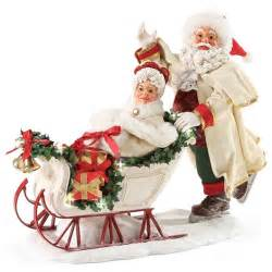 possible dreams santa pushing mrs claus on sleigh figurine 4046530 flossie s gifts and