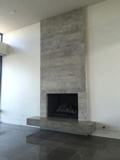 board formed concrete veneer tile fireplace surround