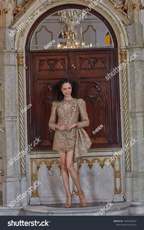fashion beautiful model in a short gold dress #Sponsored