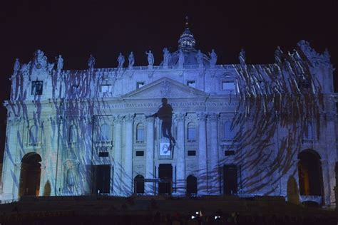 vatican city light show projects huge animal images  st