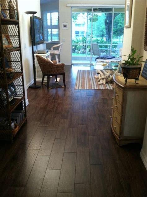 tile flooring venice fl 6x24 walnut porcelain plank tile installation in a condo in sarasota venice florida ceramictec
