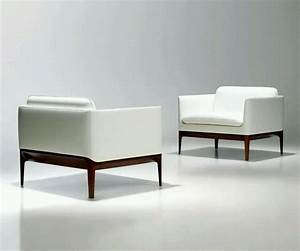 Modern beautiful white sofa designs an interior design for Modern white sofas