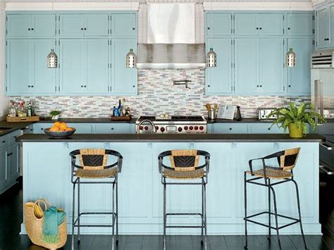 a light blue shade on the cabinets and island complements
