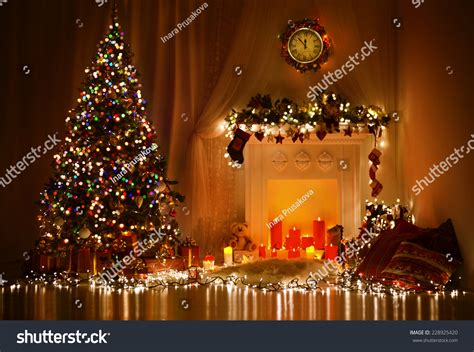 designer christmas lights room interior design tree decorated by lights presents gifts toys candles and