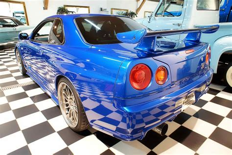 nissan skyline 2002 paul walker nissan cars news r34 skyline driven by paul walker up