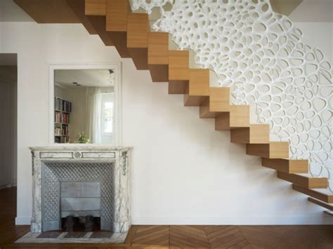 sculptural staircase handrail doubles  decorative room