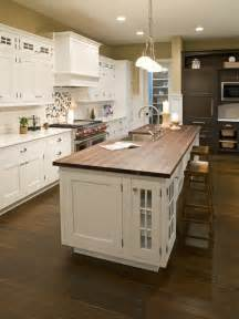 white kitchen island with butcher block top white kitchen with stained butcher block island design i would extend the butcher block to