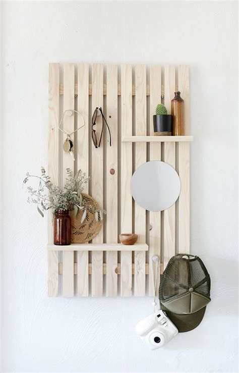 Today we're going to walk you through how we did our wood slat wall in our new living room space. DIY Slat Wall Shelf | 1000 in 2020 | Wooden wall shelves, Wood slat wall, Wooden wall decor