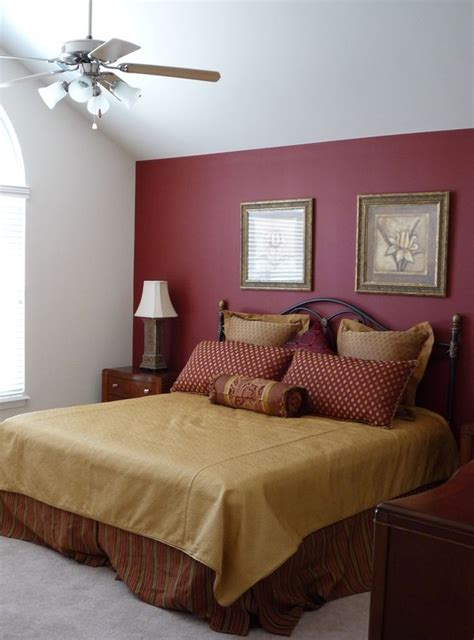 large master bedroom  red accent wall paint