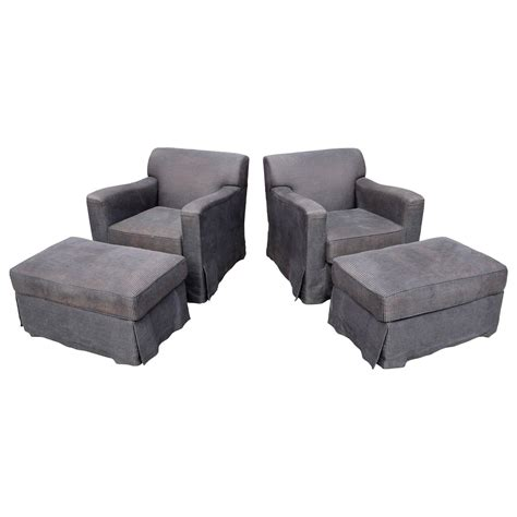 pair of christian liaigre lounge chairs with ottomans for