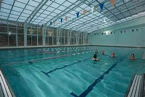 Indoor pool with retractable wilson39s fitness office for Indoor pool with retractable roof
