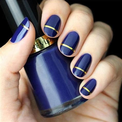 Picture Of Royal Blue Nails With A Gold Stripe