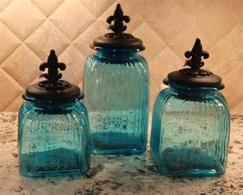 tuscan  world fleur lis teal blue glass canisters