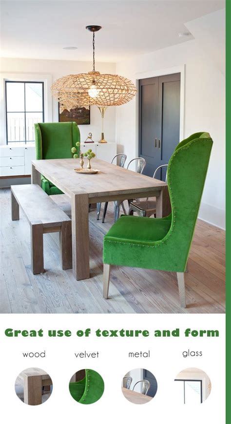 emerald green wingback chairs in a modern rustic dining