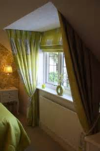dormer window with show curtains and matching blind