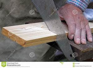 Wood Workshop Carpenter Cutting Plank With Hand Saw