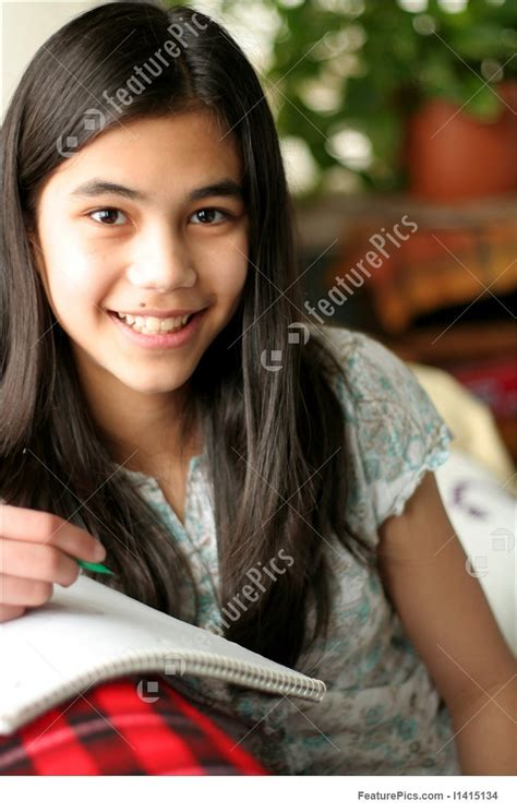 Young Teen Girl Writing In Her Notebook Stock Image I1415134 At Featurepics
