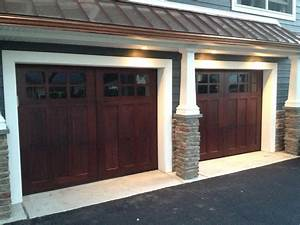 Wood garage doors premium quality wooden garage doors for Cost of carriage garage doors