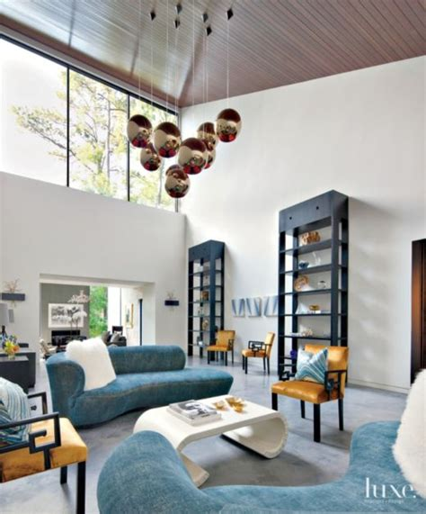 modern white double height great room luxe interiors
