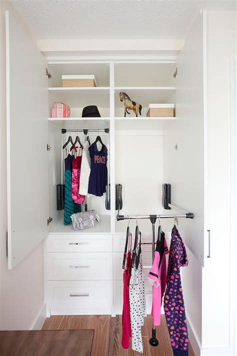 custom closet with pull clothes rail transitional