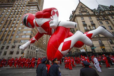 red ranger balloon    macys  annual parade