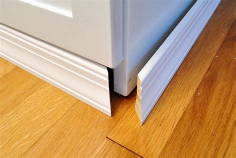 trim around kitchen cabinets adding molding to cabinets to make them look built in