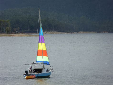 Sailboat Small by Image Of Small Sailboat Towing A Dinghy Freebie Photography