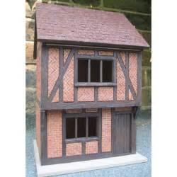 small tudor dolls house  scale externally decorated
