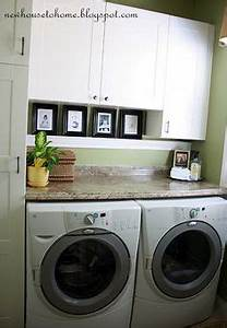 Numerar laundry room laundry room countertop laundry for Kitchen cabinets lowes with theater room wall art