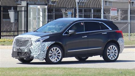 cadillac xt spied showing    design cues