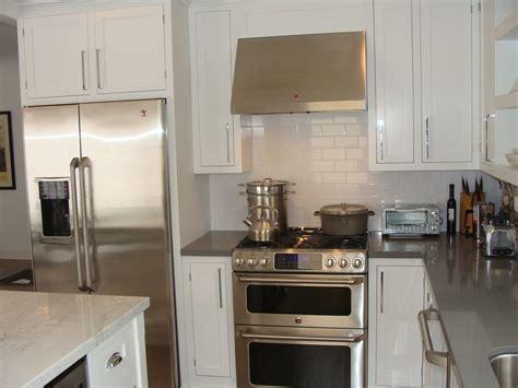 white kitchen cabinets subway tile backsplash custom shaker white inset maple cabinetry concrete gray 2059