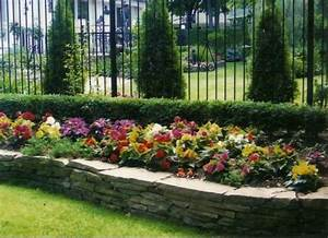 Raised flower beds against fence plant life Pinterest