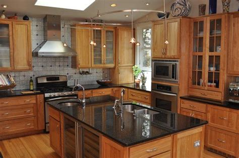 kitchen cabinets with black granite countertops granite countertops on maple cabinets kitchen 9831