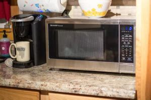 can i put a countertop microwave in a cabinet can you put a microwave in a cabinet simply better living