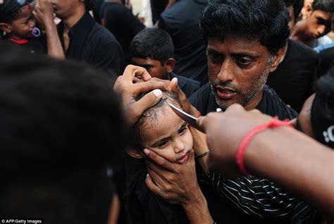 wrap dress islamic festival of ashura continues as children smear