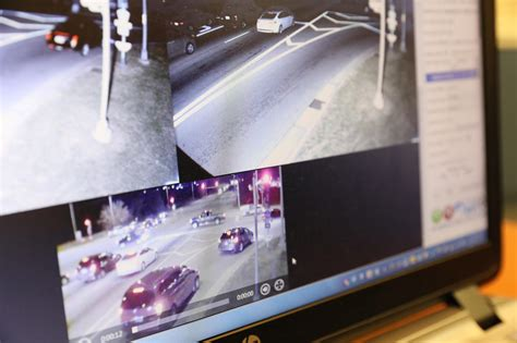 chicago red light camera tickets some suburbs take only seconds to review red light camera