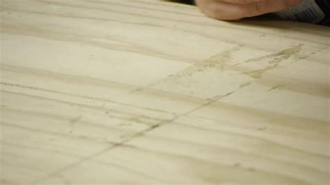 how to remove a peel and stick tile adhesive from