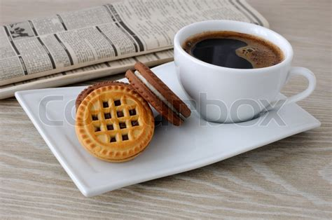 A Cup Of Coffee And Biscuits And A Newspaper Espresso Coffee Machines Ottawa Ethiopia Development Makers Top 10 Maker For Home Use Ethiopian Characteristics Cups Greensboro Packaging