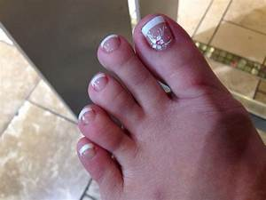 Gel French pedicure with a white flower for decor