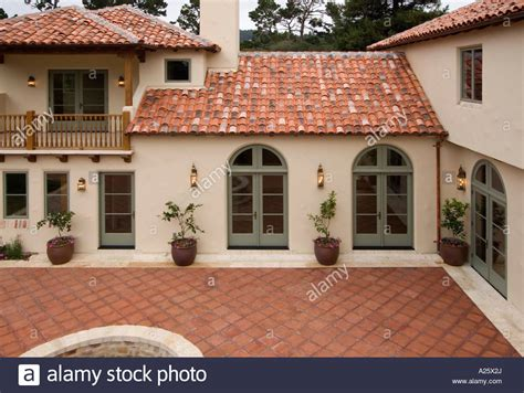 exterior   spanish style luxury home  stucco walls