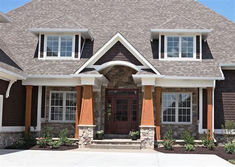 custom home white brick exterior decorative apron