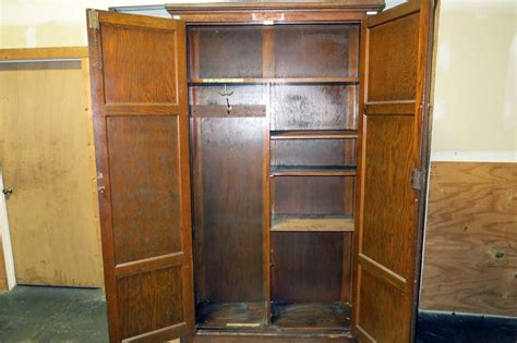 Large Wardrobe Cabinet by Lot 114 Large Wooden Cabinet Wardrobe Wirebids