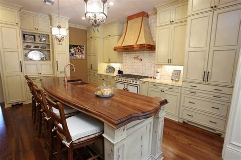 pictures of kitchen islands with seating modelos de mesones de cocina fotos