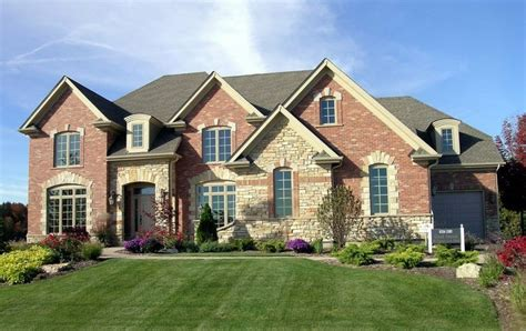 Red Brick With Light Stone Accents  Exterior Materials