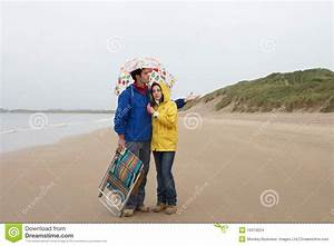 Young Couple On Beach With Umbrella Stock Images - Image ...