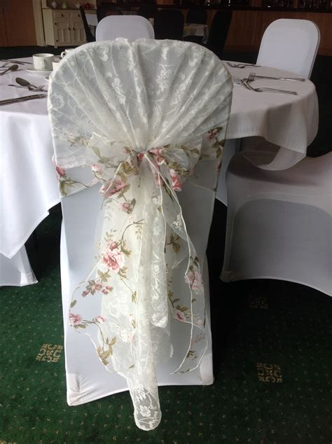 beautiful vintage lace chair hood with floral organza sash available to hire from make it