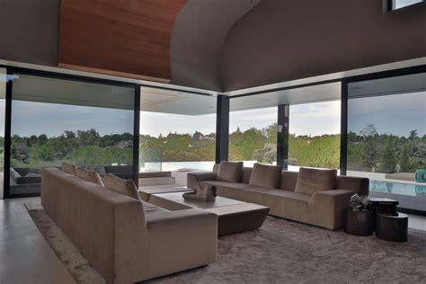 glass walls living room futuristic home  madrid spain