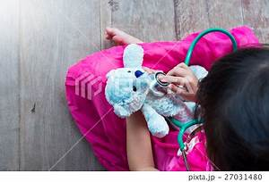Top view of child playing doctor with plush toyの写真素材 ...