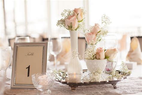 shabby chic wedding tables teacups and silver trays gave the centerpieces a shabby chic feel photo by roohi photography